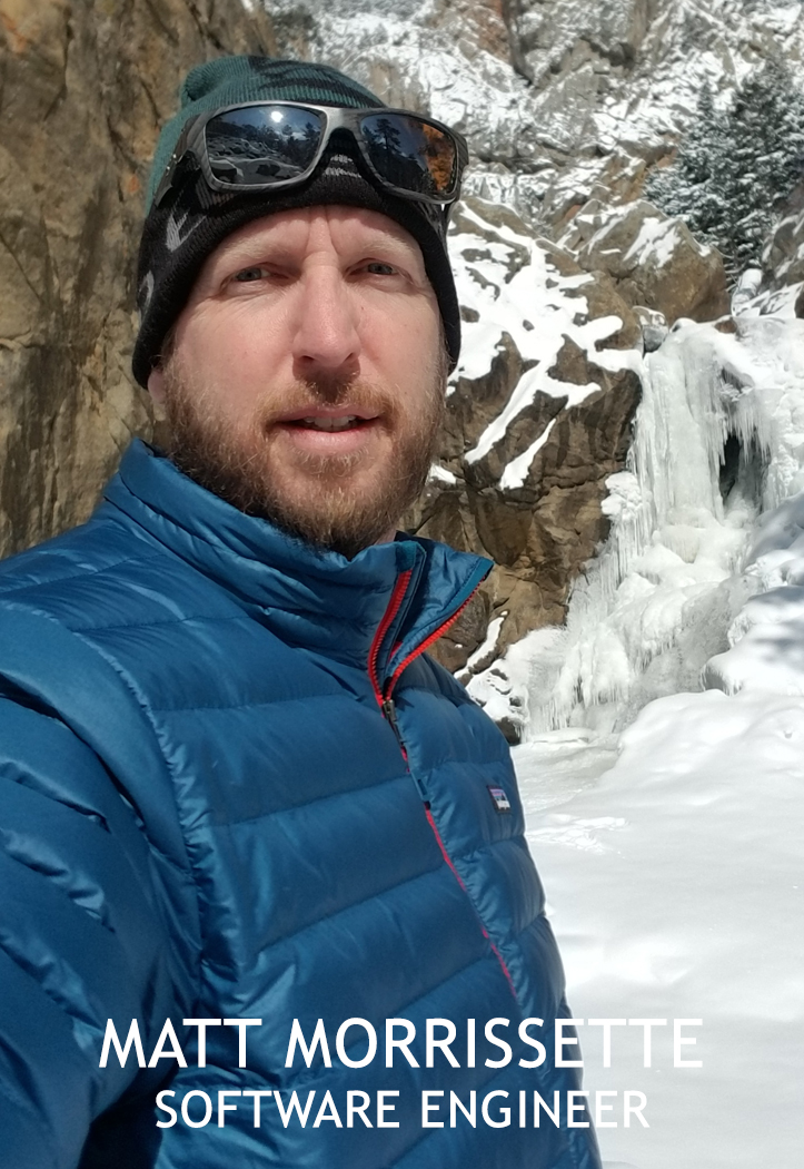 Portrait of a man in a mountain setting with snow and ice..